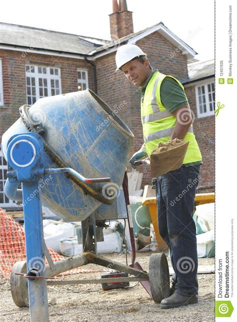 Construction Worker Mixing Cement Royalty Free Stock Photo
