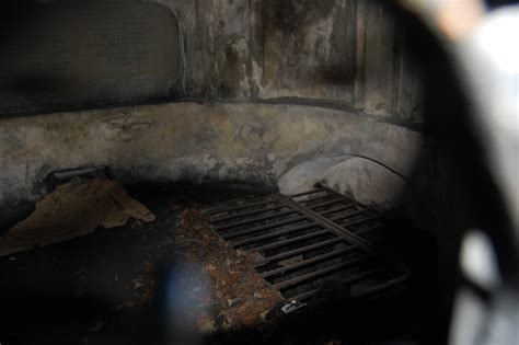 inside the black mausoleum   in 1999, a homeless person