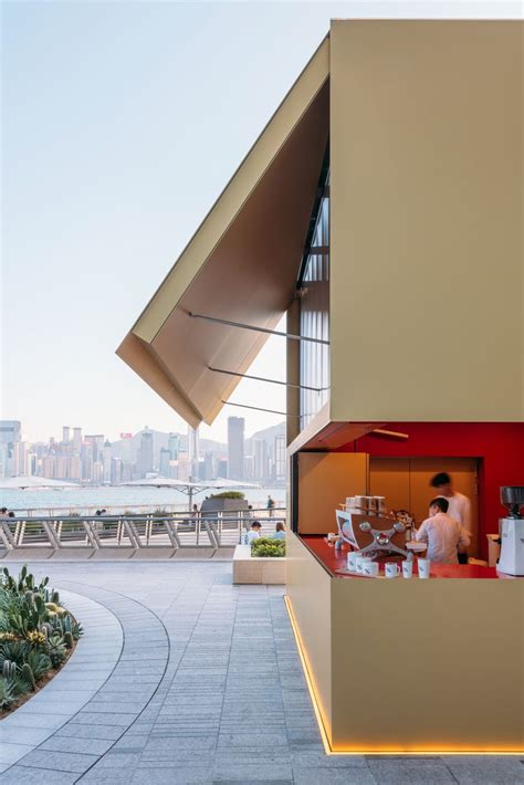 OMA realize gold colored anodised aluminum kiosk at Hong
