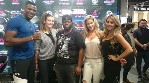 Miesha Tate and Francis Ngannou take pictures with fans